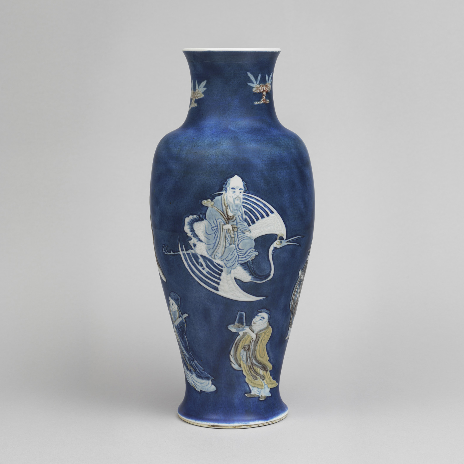 Chinese porcelain baluster vase carved on the body and applied with the eight immortals in blue and white, celadon and copperred,