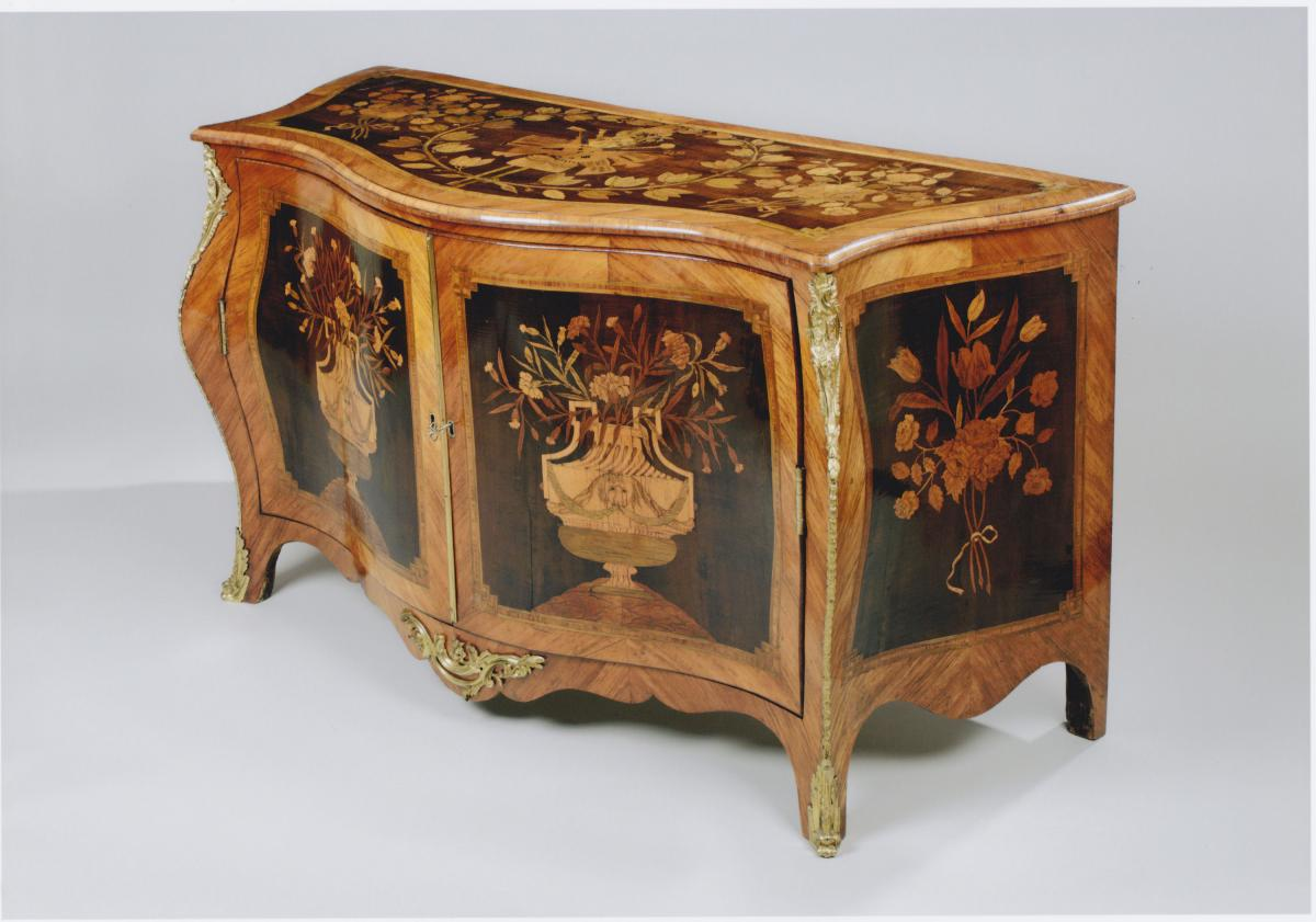 A George III Ormolu Mounted Harewood and Marquetry Serpentine Commode Attributed to Pierre Langlois    Circa 1765