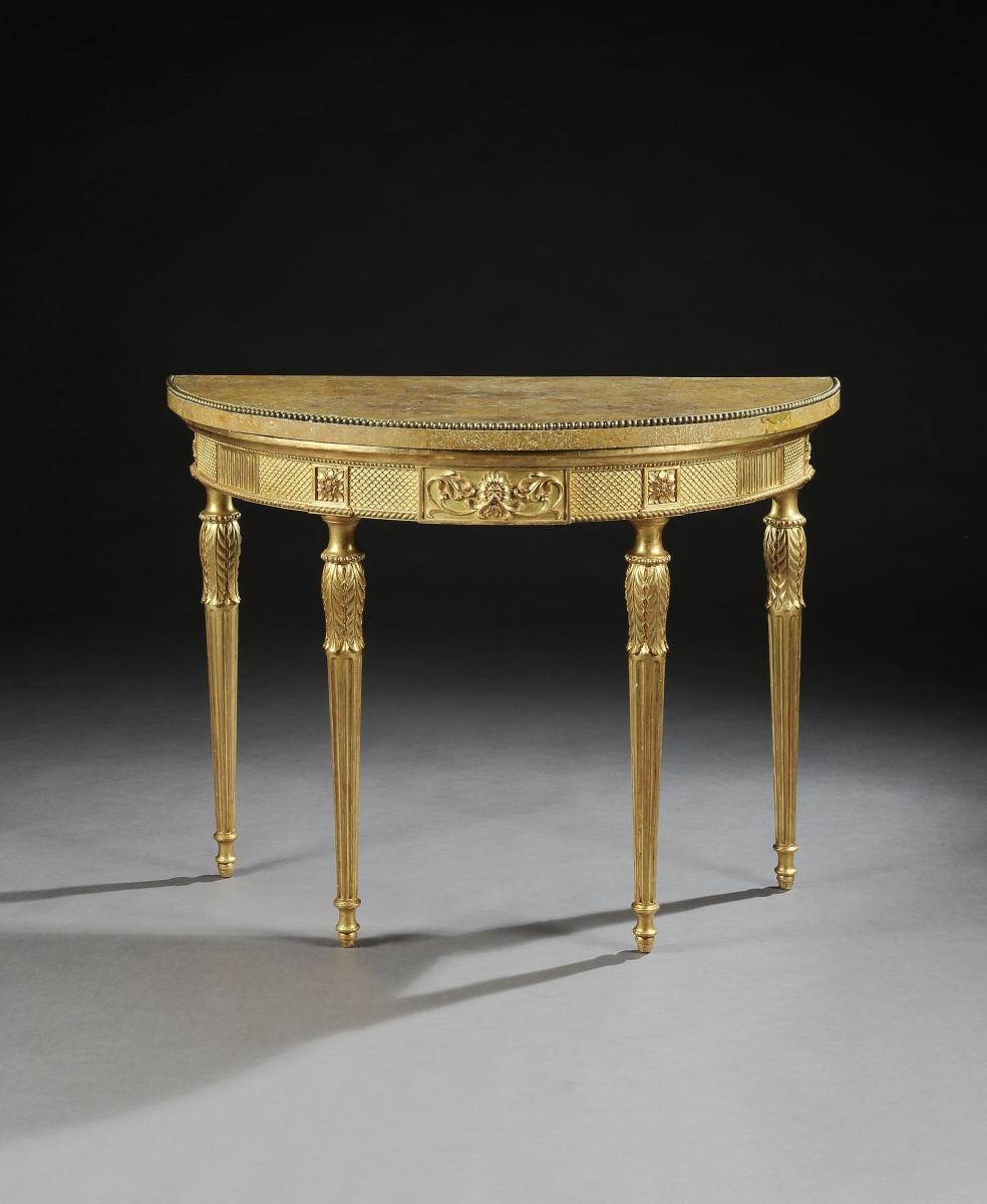 A Pair of George III Giltwood Demilune Tables attributed to Thomas Chippendale