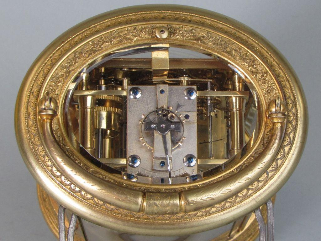Drocourt An engraved oval carriage clock escapement