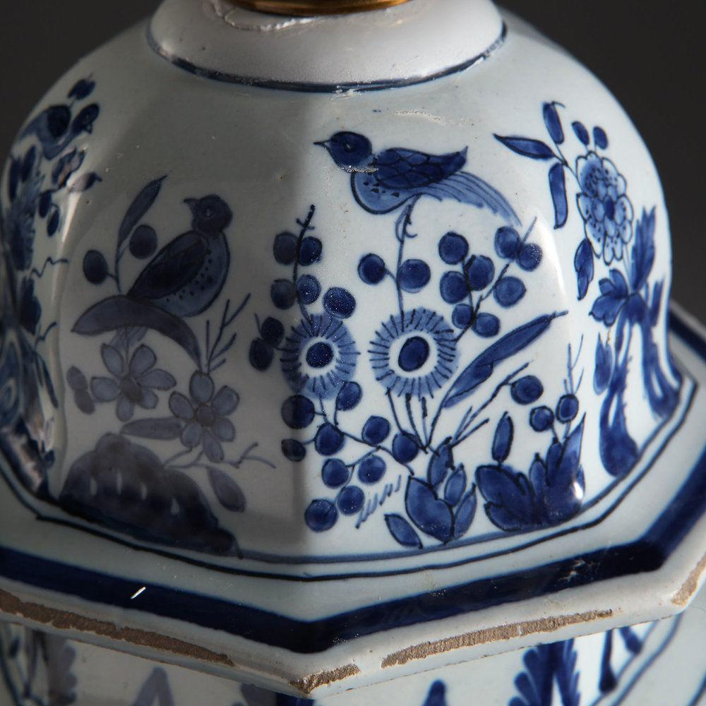 Low Countries, circa 1860  A pair of mid 19th century blue and white Delft vases, decorated with birds, chrysanthemums and other