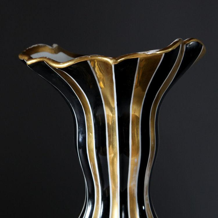 A PAIR OF NAPOLEON III BLACK AND GOLD VASES