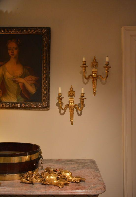 A pair of French neo-classical two light candle sconces.