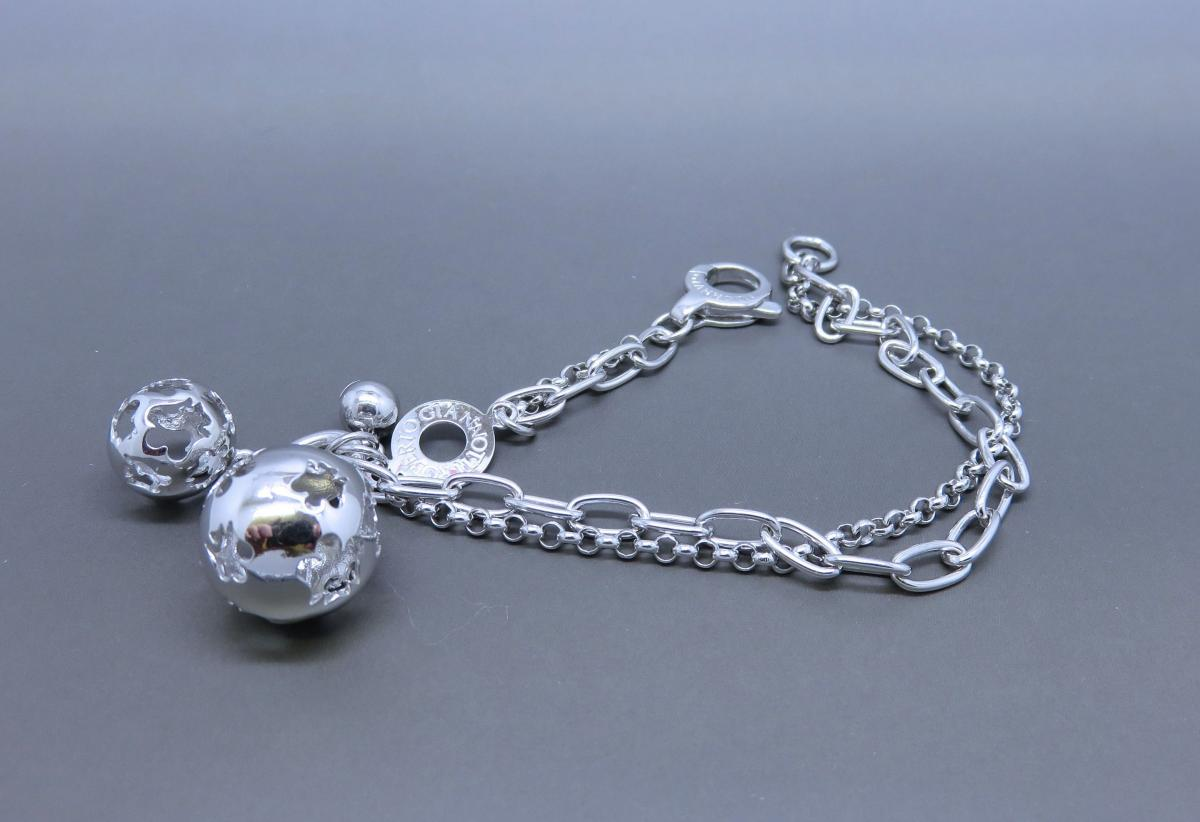 A Sterling Silver Bracelet With Charms