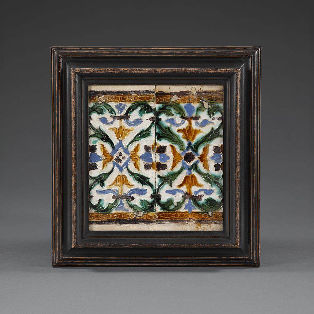 A mid 16th century pair of yellow and green glazed Spanish ceiling tiles.