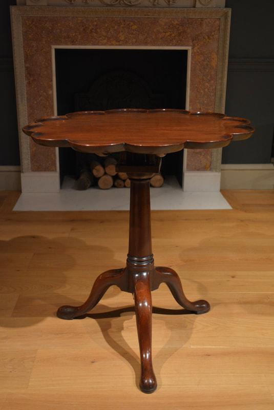 A George II lobed top mahogany tripod table, Circa 1750
