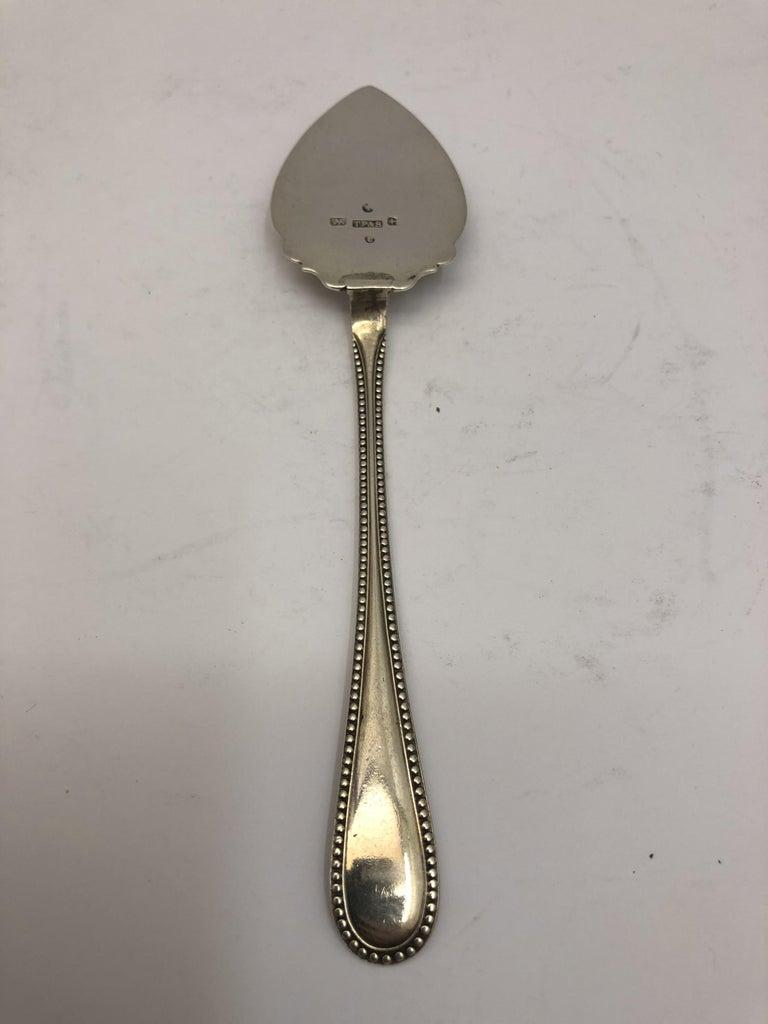 Small Silver Butter Spade with Decorated Border by Thomas Prime