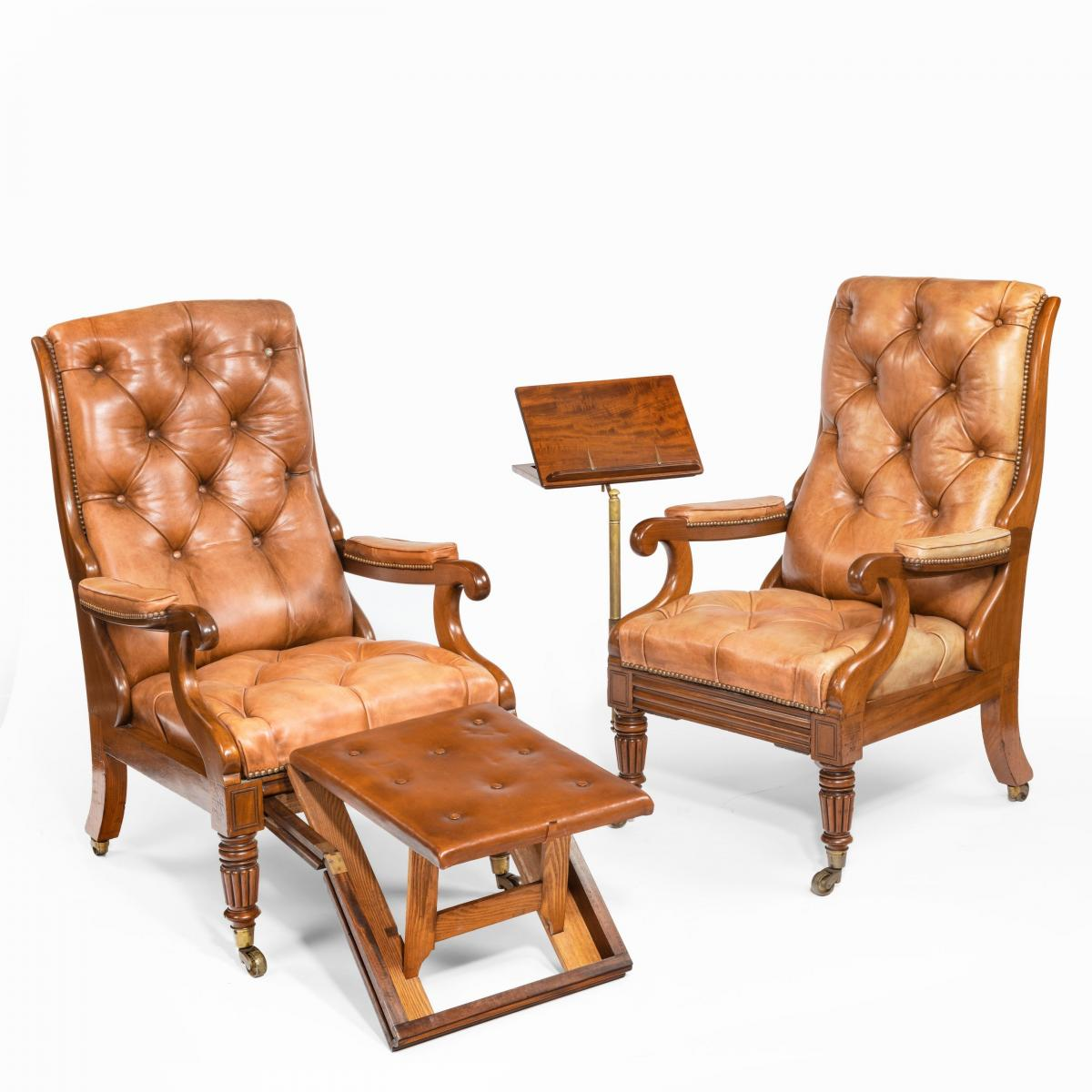 A pair of William IV adjustable mahogany library armchairs, by George Minter