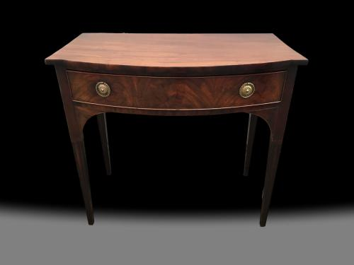 George III bow front mahogany table