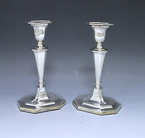 A Pair of Edwardian Sterling Silver Candlesticks made by Martin Hall & Company in 1906