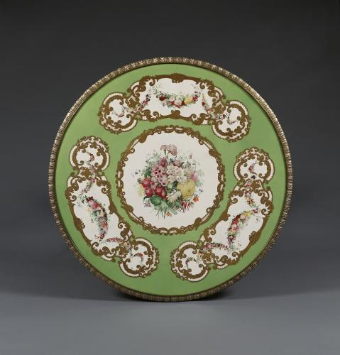 A Satinwood And Gilt-Brass Mounted Circular Center Table Bearing An Exquisite 'Adelaide Green' Porcelain Top By Copeland & Garrett