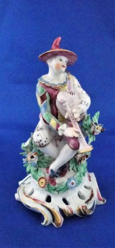 A Bow porcelain figure of a harlequin