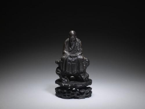 A Chinese Guangdong Stoneware Figure of a Seated Immortal