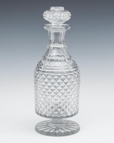A RARE REGENCY DIAMOND CUT PEDESTAL FOOT DECANTER