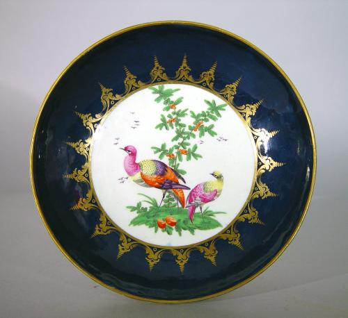 First Period Worcester Porcelain Blue-Ground Exotic Bird-decorated Cake Plate,  Circa 1770.