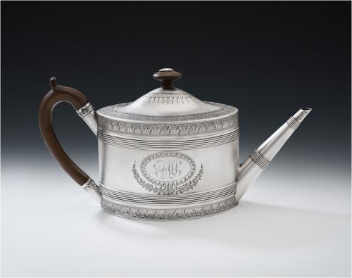 An antique sterling silver teapot made in London in 1787 by Benjamin Mountique