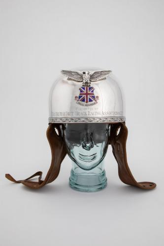 A rare silver winged trophy helmet awarded by the British Dirt Track Racing Association Ltd. in 1928 or 1929.