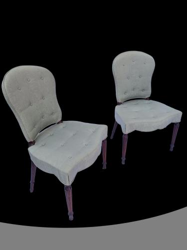 Pair of George III mahogany serpentine upholstered chairs
