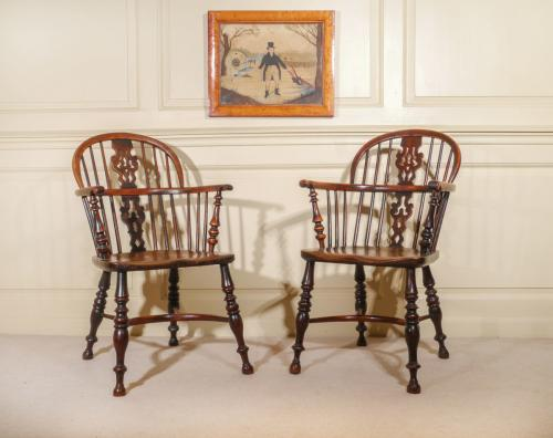 A Fine Set of Four Yew Wood Low Back Windsor Armchairs