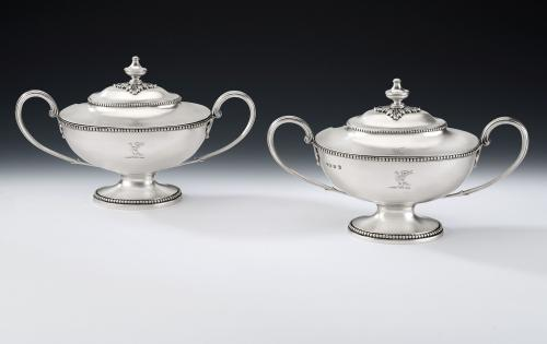 A very fine pair of George III Neo Classical Sauce Tureens and Covers. Made in London in 1777 by Thomas Evans.
