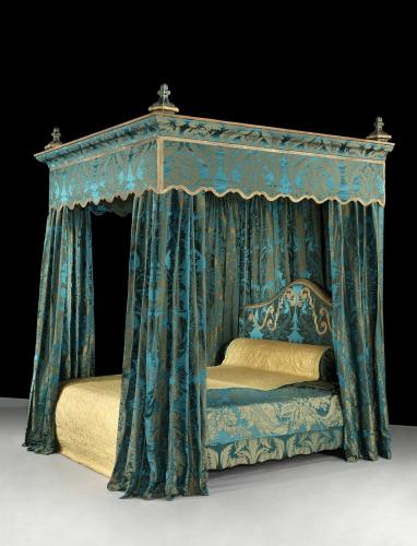 A massive, 19th century, State Bed re-upholstered in a blue, silk damask brocade