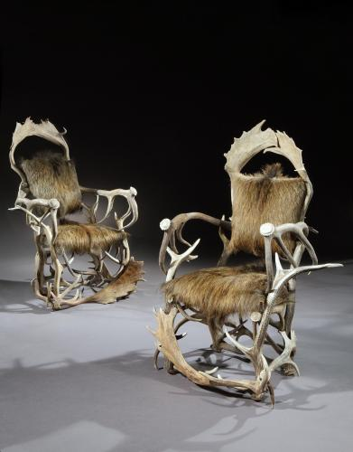 A magnificent pair of late-19th-early-20th century, trophy armchairs