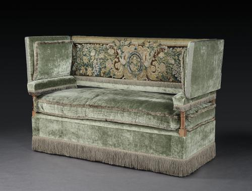 An early-20th century, Knole settee with a verdure tapestry fragment incorporated into the back