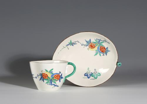 A Chantilly Kakiemon Peach-Shaped Cup and Saucer