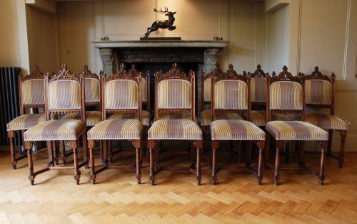 A set of 12 19th Century Gothic Revival Dining Chairs