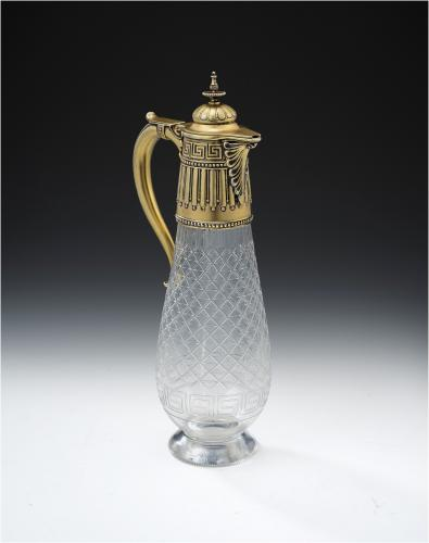 The Royal Silversmith, Robert Garrard. An extremely fine and very unusual silver gilt mounted Wine Jug made in London in 1877 by Robert Garrard