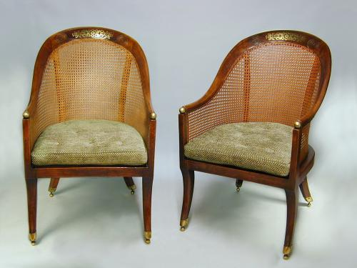 Pair Regency brass inlaid simulated rosewood caned bergeres, c.1810