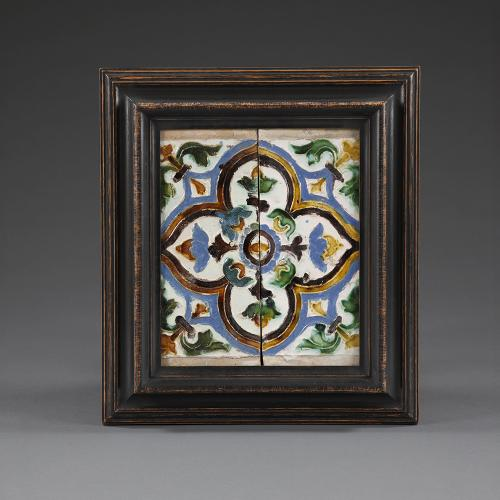 A pair of mid 16th century Spanish tiles