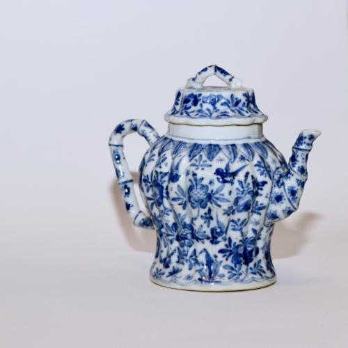 Chinese porcelain blue and white baluster-shaped teapot and matching cover of bamboo form painted on the moulded body with birds, flowers and insects, all below a raised band of pendant leaves, 13.5cm high, Kangxi circa 1700. Perfect condition.