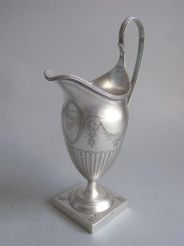 A George III Helmet Milk Jug made in London in 1789 by John Lambe