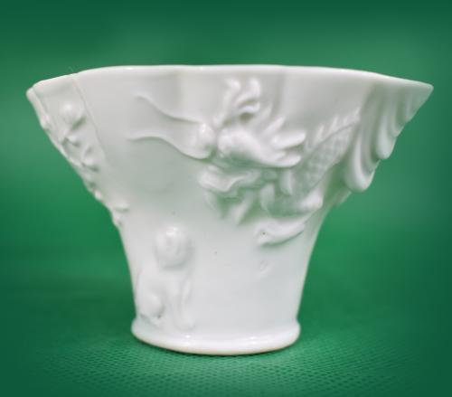 Blanc-de-chine libation cup depicting a tiger, dragon and a deer