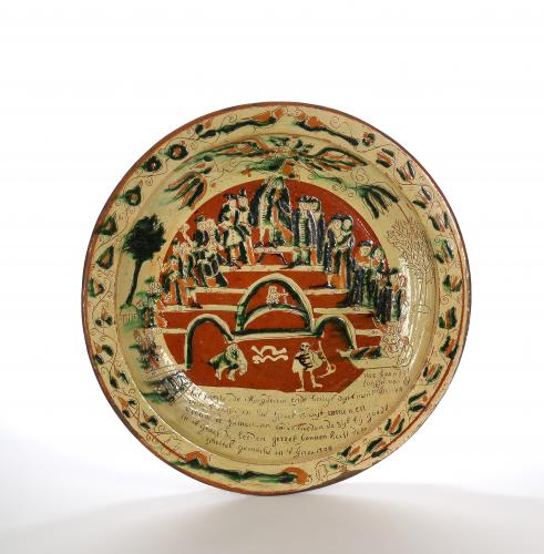 A Large Incised Slipware Dish