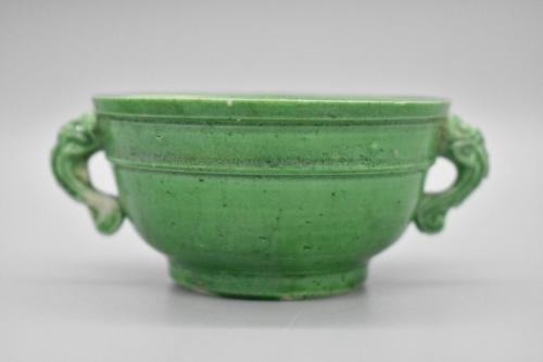 A green-glazed miniature guy vessel form cup with mythical beast handles.