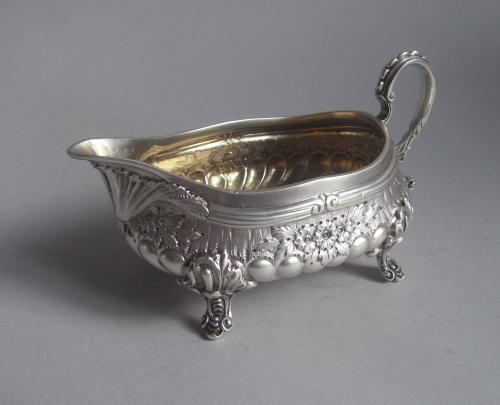 A rare cast Cream Boat, in the manner of Paul De Lamerie, made in London in 1890 by Frederick Bradford McCrea