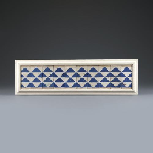 A set of ten Cuenca blue and white tiles with a wavy Renaissance pattern