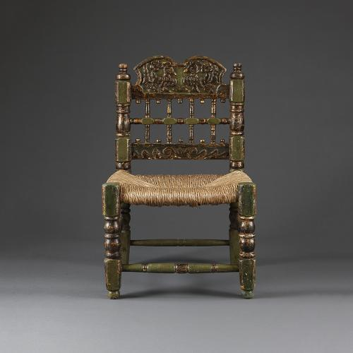A pair of Spanish green and giltwood chairs