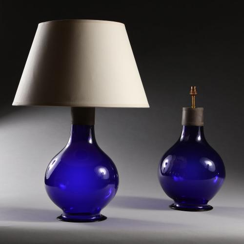 A Pair of Imperial Blue Glass Lamps