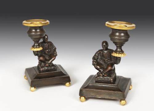 Pair of Regency Bronze & Gilt Brass Candlesticks depicting seated Chinamen English Circa 1810