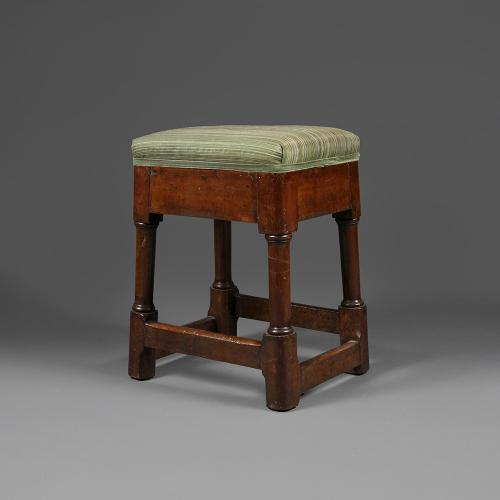 An oak overstuffed stool