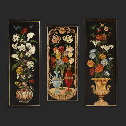 A set of three 20th century Art and Crafts painted panels.