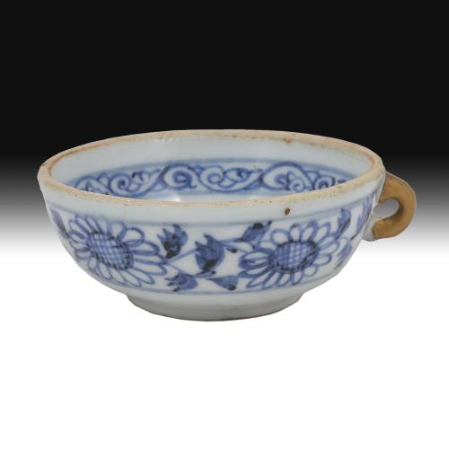 Blue and white cup with gold painted (Japanese Kintsugi restoration) handle.