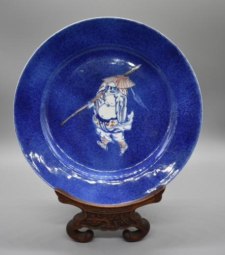 A Powder Blue Background Dish Depicting a Sage in underglaze red