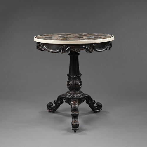 An early 19th century Specimen marble top on a mid 19th century ebonised base