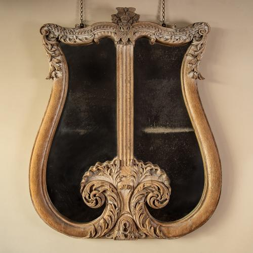 A monumental lyre-shaped overmantle mirror