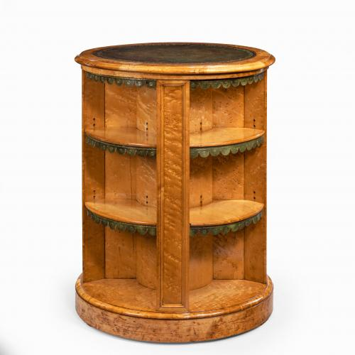 A late Regency bird's eye-maple cylindrical open bookcase attributed to Gillows
