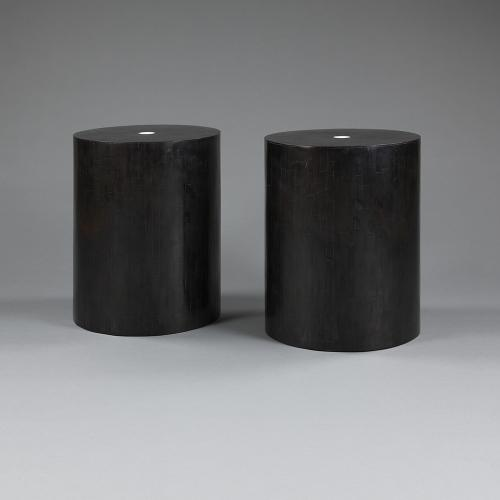 A pair of all black stools / tables